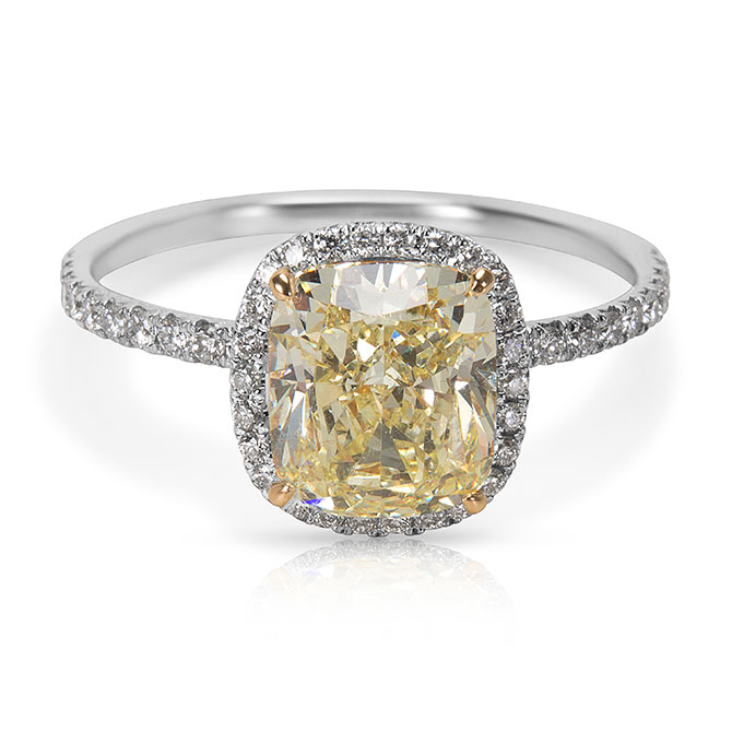A yellow diamond set in platinum