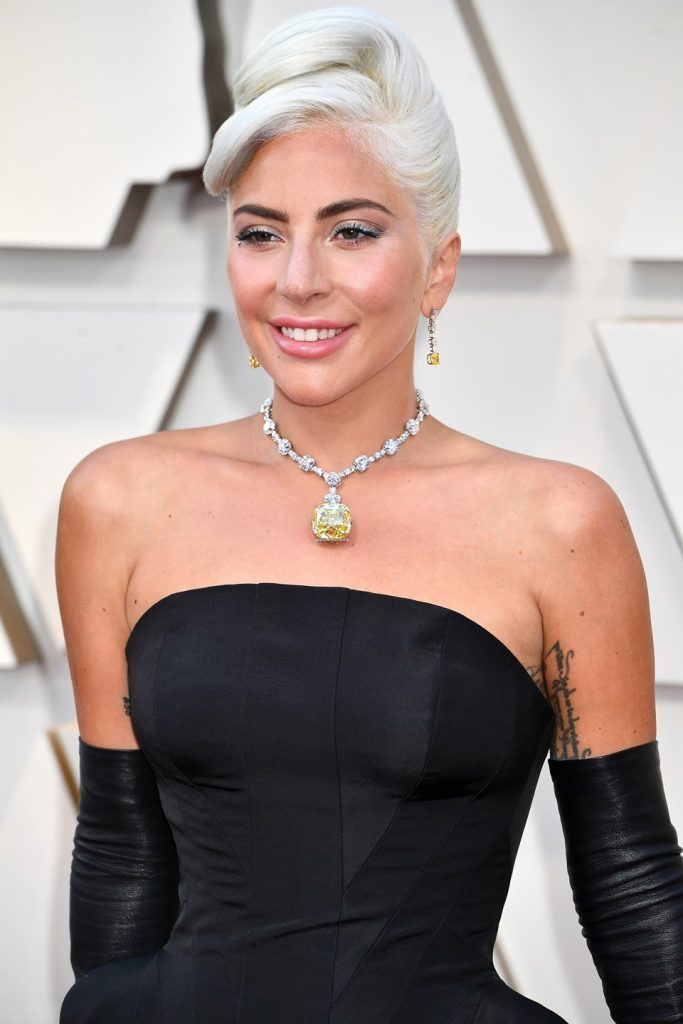 Lady Gaga wearing a diamond choker with a black tube-topped dress.