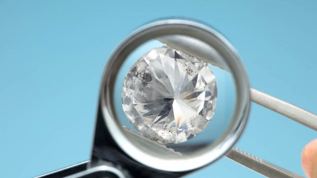 Skilled hands maintaining your enhanced diamond