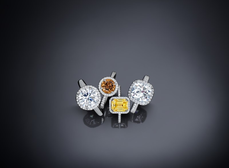 White and colored treated diamonds set in white gold rings