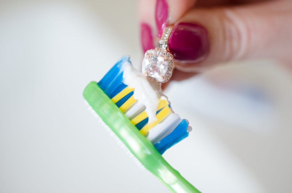 Brushing clarity-enhanced diamonds set on a gold ring