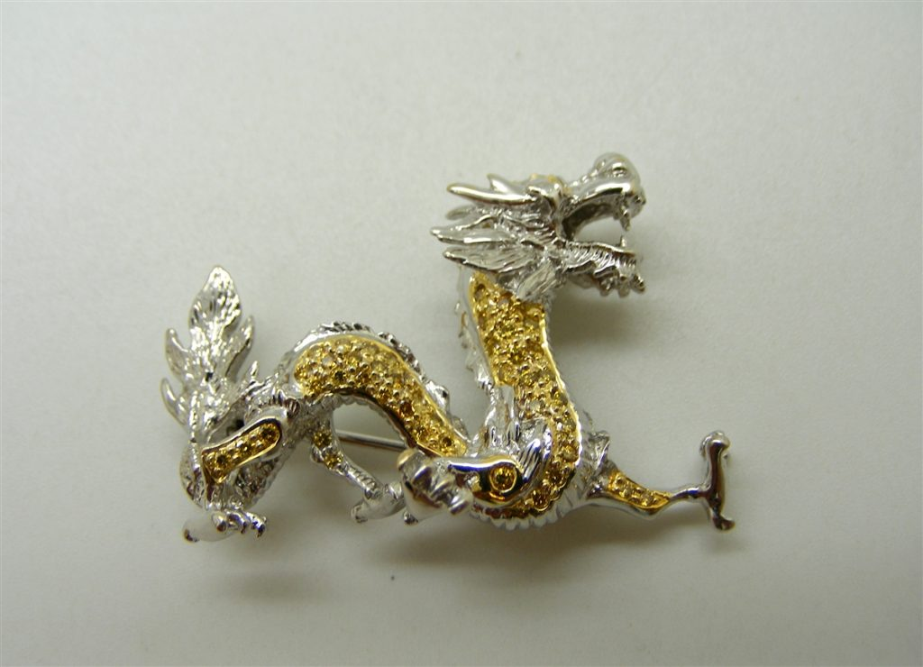 Diamonds on a gold and silver dragon pin