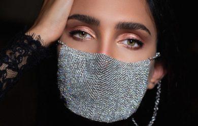 Woman wearing diamonds on her mask