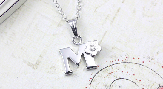 Letter pendant with a diamond flower