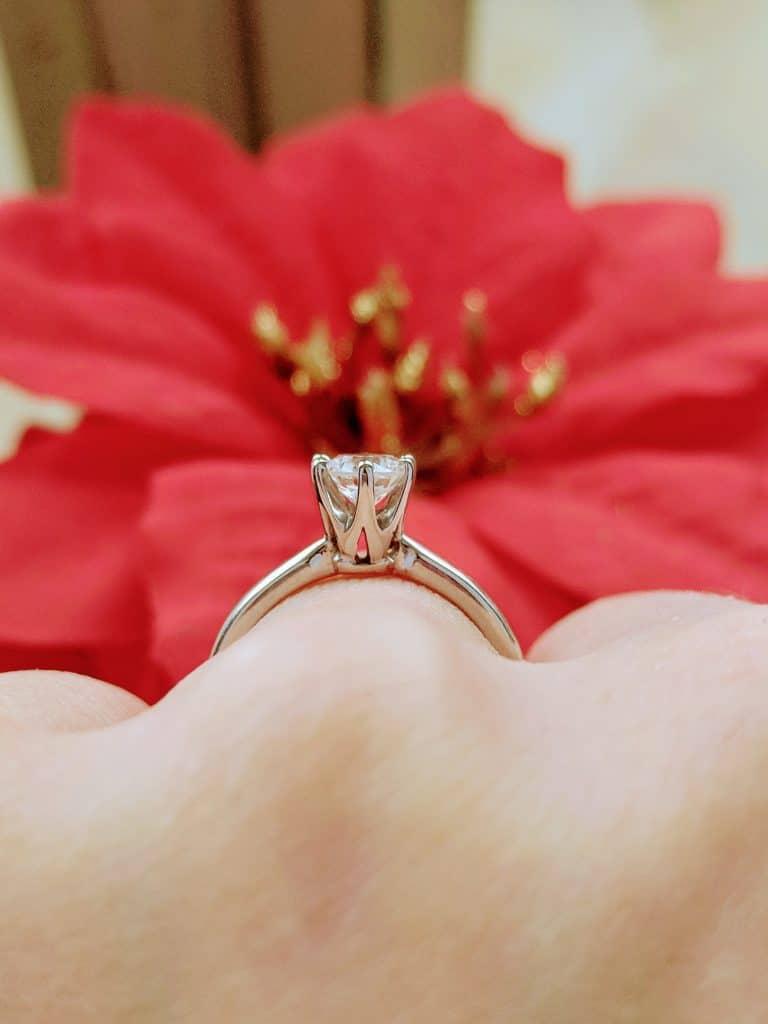 A diamond engagement ring.
