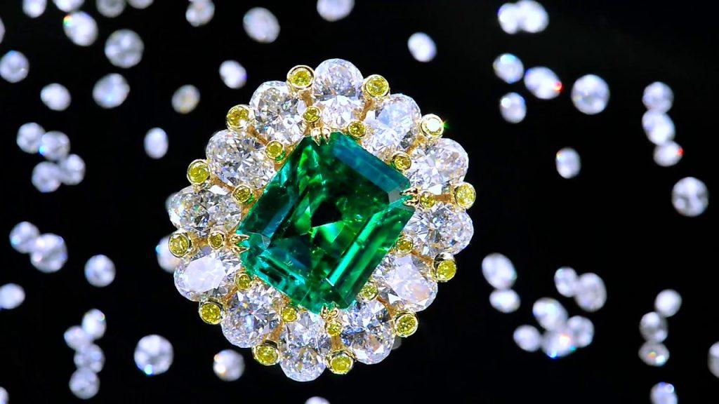 Precious green diamond surrounded by white diamonds