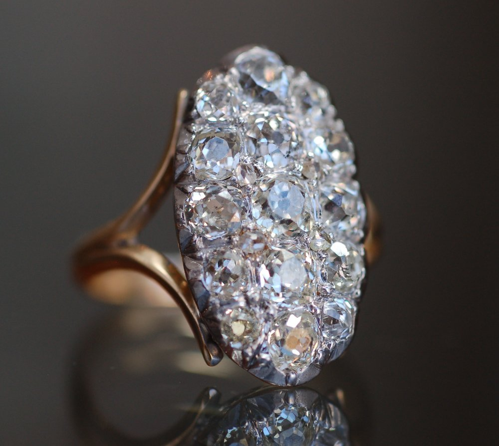 An antique diamond ring set in gold