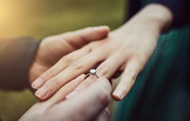 A wedding proposal with an heirloom engagement ring.