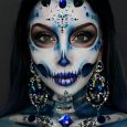 A woman with a diamond-inspired Halloween makeup