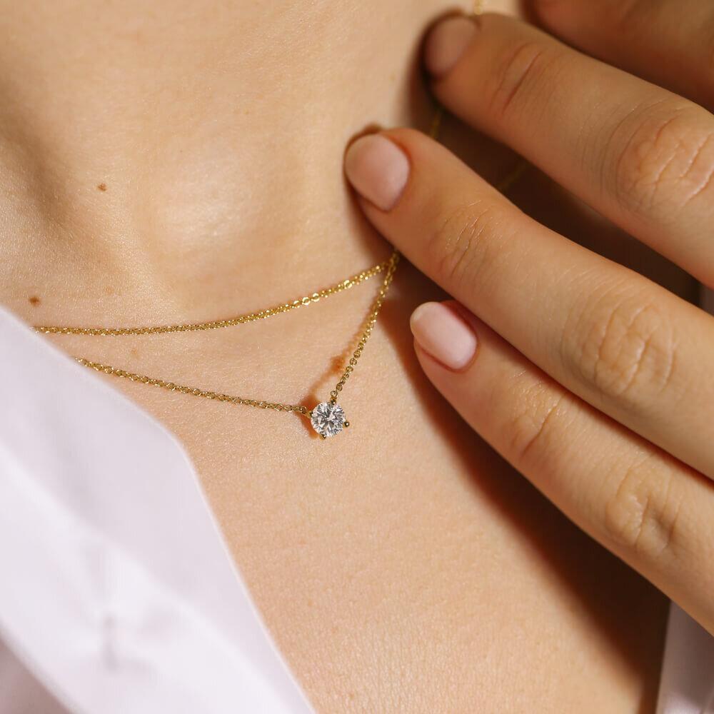 Dainty diamond pendant set on a thin, gold chain
