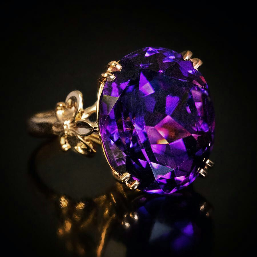 Plum diamond set in a gold ring
