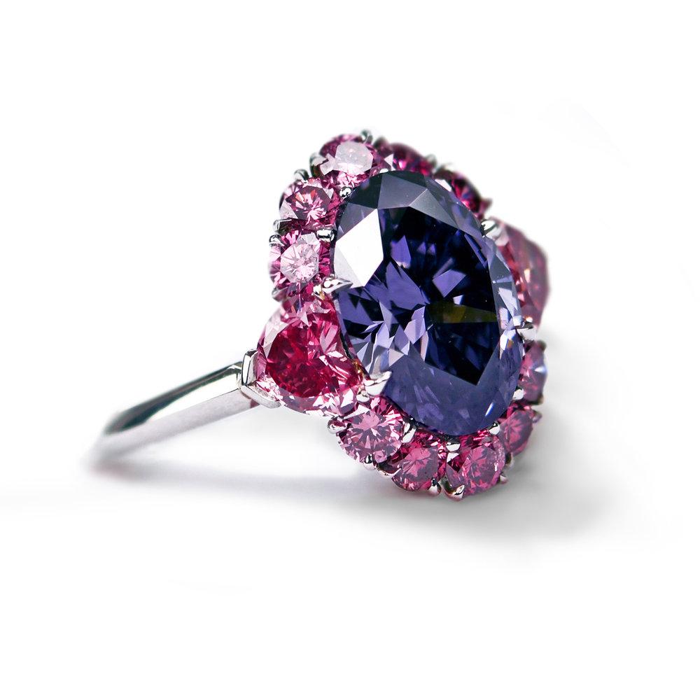 Purple diamond surrounded by pink diamonds, set in platinum