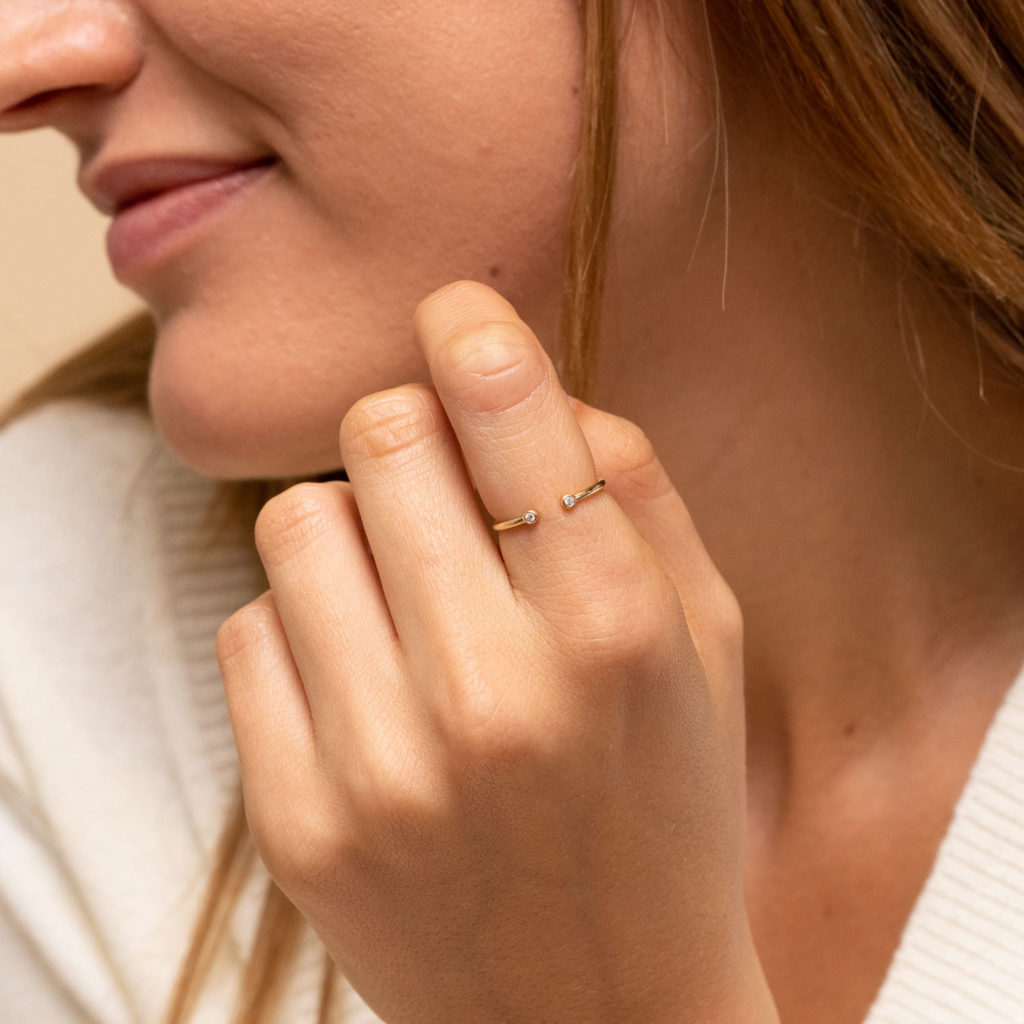 Thin, open diamond ring on your first date, wear it on your index finger