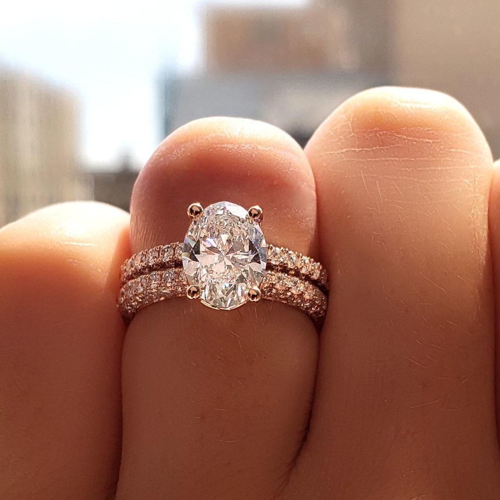 Wearing a stunning diamond engagement ring.