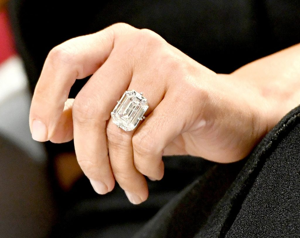 A woman with a large, diamond engagement ring.