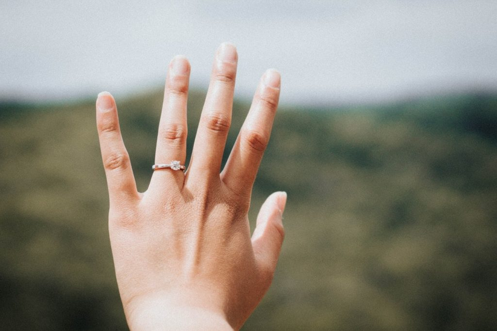 Newly-engaged woman happy with her ring