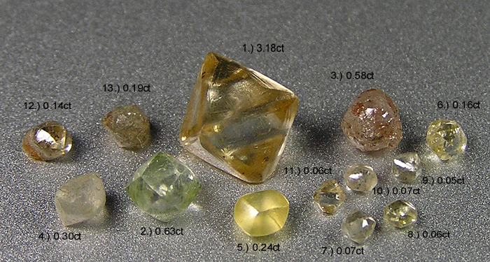 Image of various loose raw diamond crystals as unearthed.