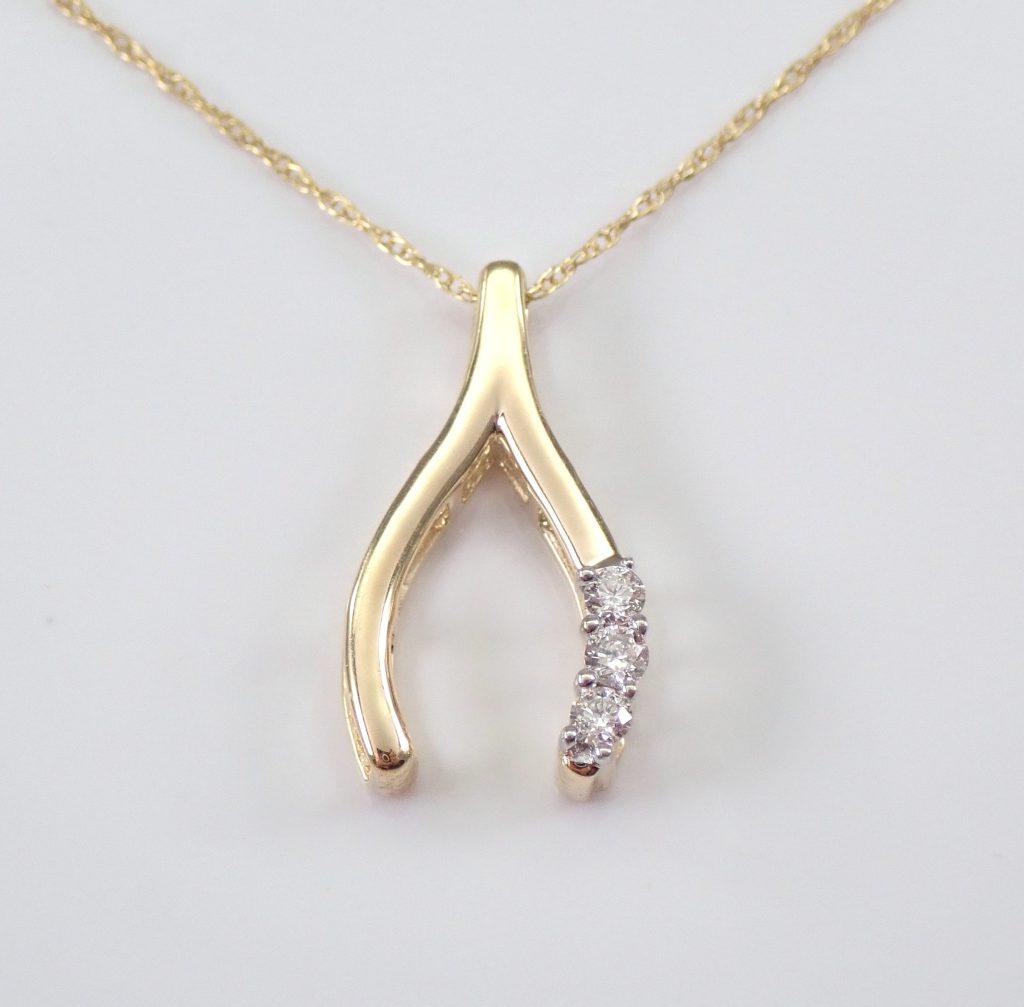 Sophisticated Thanksgiving diamonds set in gold wishbone pendant